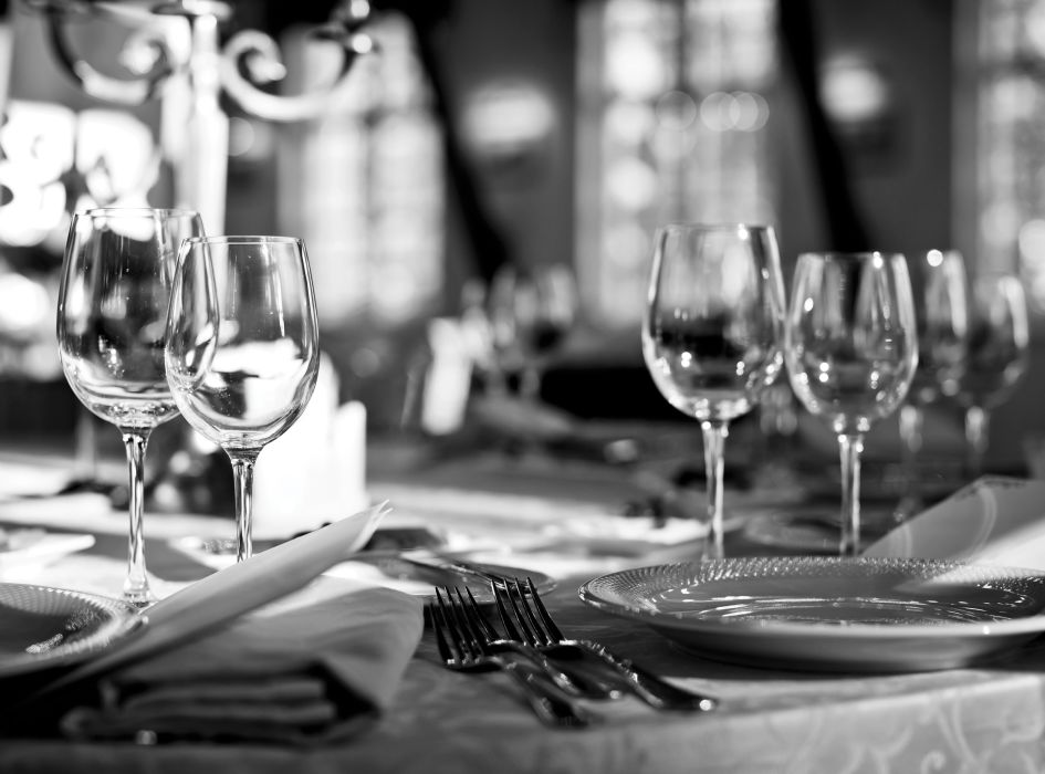 A Close Up Of An Empty Wine Glasses Sitting On A Table
